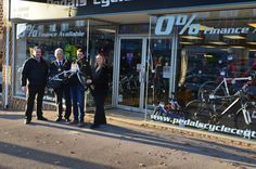 Winner of the bike, Cathy Gardiner, while receiving her prize by Shaun Flynn Chamber President - Mayor of Ferndown, Terry Cordery and Sharon Worsfold owner Pedals Cycle Centre