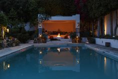 Moroccan-inspired pool  A lounge area next to this Los Angeles pool features a fireplace and Moroccan-inspired tiles and accents.  http://www.latimes.com/home/la-hm-home-inspiration-pools-photos-photogallery.html#lightbox=63587735&slide=1