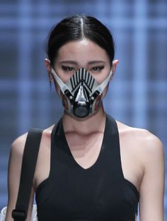 """ Smog masks at QIAODAN Yin Peng S/S 15 China Fashion Week """