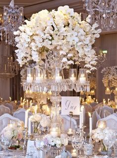 Amazing centerpiece and tablescape. Love the crystal chandeliers.