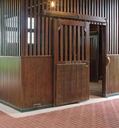 This beautiful horse barn at Faraway Farm in Kentucky was built in 1921, and is home to the stall of the famous American stallion Man o' War.