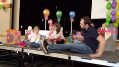Opening presents at the Candy Land First Birthday Party