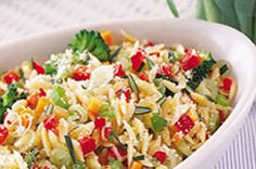Toss your choice of chopped fresh veggies into this Parmesan Orzo Primavera to make a delicious, colorful dish that's ready in 20 minutes or less.