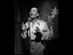 """Billie Holiday.    Quincy Jones says Leonard """"wrote the vernacular of jazz photography. I used to tell cats that Herman Leonard did with his camera what we did with our instruments….Herman's camera tells the truth, and makes it swing."""""""