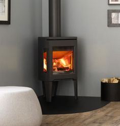 JotuI Wood Burning Stove – Stovesman Ltd – Freestanding fireplace wood burning Indoor Fireplace, Faux Fireplace, New Homes, Contemporary Fireplace, Corner Stove, Wood Burning Stove, Fireplace, Freestanding Fireplace, Small Room Size