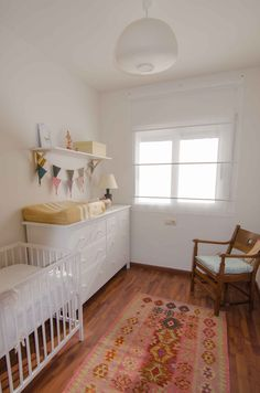My little girl's nursery. Changing table (hemnes) and shutters (ringblomma) from Ikea. Recicled armchair and crib.