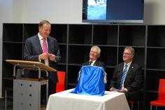 Prime Minister John Key talks about his tie matching Principal Catherine Wouters's shirt,  with Director Don Kendall and CEO Noel Turner