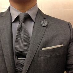 Love the textured tie with all grey