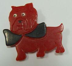 RED BAKELITE BULLDOG W/ BOW TIE  PIN. Originally pinned by Colleen Abbott (colleen466)