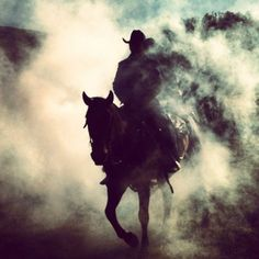 Love this shot of this Cowboy coming through the dust !