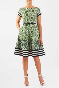 Our graphic pinwheel print cotton cambric dress is cinched in with a self-belt at the seamed waist. The fitted bodice and flared skirt are classically flattering, while pockets and a contrast banded hemline offer modern elements.