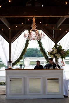 Elegant Draped Wedding Car with Greenery Garlands and a Crystal Chandelier | Paige Winn Photography on @eld_lauren via @aislesociety
