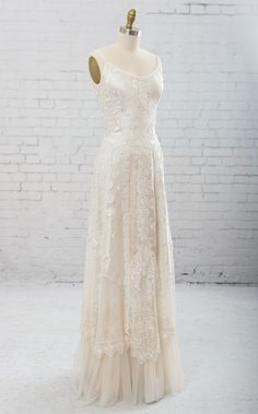 Diana by Martin McCrea | Sleeveless wedding dress with straps. Bodice of bias cut embroidered silk dupioni. The skirt is a collection of artfully arranged laces and trims. Includes shawl of embroidered chiffon and guipure lace.