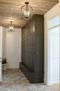 Beautiful storage space for the laundry or mud room. The lighting fixtures compl… Beautiful storage space for the laundry or mud room. The lighting fixtures compliment the rustic ceiling perfectly.Parade Of Home Home Interior, Interior Design, Kitchen Interior, Br House, Halls, Mudroom Laundry Room, Mud Room Lockers, Sweet Home, Wood Ceilings
