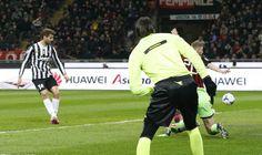 Juventus\' Llorente shoots to score against AC Milan during their Italian Serie A soccer match at the San Siro stadium in Milan