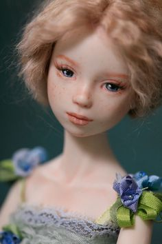 Bluebelle- a delicate little lady in her party dress and bonnet. She has delightful freckles and wavy, soft blonde hair. Her hair can be let down