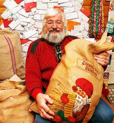 Age won't keep the Drøbak Santa, the Norwegian Julenisse, from his work, as he holds his bag of postcards and letters from all over the world. All Over The World, Norway, Postcards, Christmas Sweaters, Men Sweater, Santa, Letters, Age, American