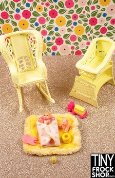 This set is so cute! Includes light yellow faux wicker rocking chair (that rocks), rocking bassinet with shelf underneath, soft play mat, baby, swaddle and other baby accessories pictured. Watch the r