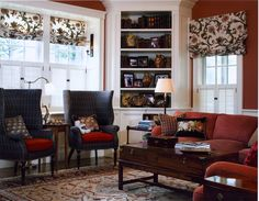 Living Room - Benson Interiors  Boston, Ma  www.bensoninteriors.com  #livingroom #interiordesign #red #chair #couch #lamps #windowtreatments #woodtrim #bookcase #white #flowers #coffeetable #mixandmatch