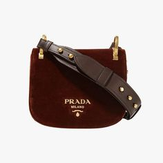 "Emily Farra, Vogue.com Fashion News Associate - ""Prada's new Pionnière is everything I want in a fall bag. It's small, but deceptively roomy; has a thick, comfy leather strap; and it comes in the richest chocolate brown velvet. If only I could get my hands on it in time for Fashion Week!"" Prada Pionnière velvet shoulder bag, $1,770, net-a-porter.com"