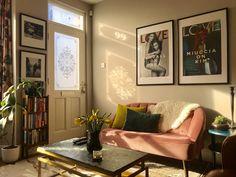 My home, #livingroom #farrowandball #elephantsbreath #pinkvelvet #pinkvelvetsofa #eclecticlivingroom #framedposters #greenmarble #antiquebookshelf