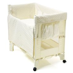 Arms Reach Co-Sleeper. Ours was bigger the size of a pack n play n we used it for 6 months loved it!!