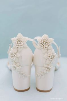 Comfortable statement heels for your wedding! These embellished bridal shoes with a block heel are the perfect embellished heel sandals for summer brides who are getting married outdoors -you can now walk on grass without sinking! Featuring 3D floral pearls & a sweet ankle strap, you can dance all night in these Bella Belle beauties! #bridal #bridalshoes #weddingshoes #weddingheels #bridalheels #bellabelleshoes #bellabelle @bellabelleshoes