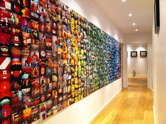 The Lomo wall is complete, by  Will Cheyney. More about lomography here: http://www.lomography.com/