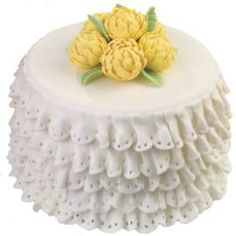 The ruffle look is neat, but maybe too feminine for Dad to like it too.  I would do different flowers on top.