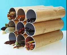 At totallygreencrafts.com you can read how to make a fantastic stationary holder from upcycled Pringle tubes!