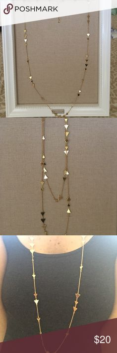 Stella&Dot Alexia layering necklace Long gold layering necklace with triangle detail along the chain. Can be worn long or doubled, adjustable clasp options. Only worn once, the necklace is in great shape, one tiny link at the top near the clasp is tarnished (see picture 4) but the rest of the necklace is in excellent condition, no damage. Comes in original box. Stella & Dot Jewelry Necklaces