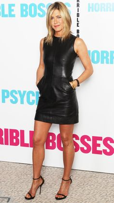 Jennifer Aniston promoted Horrible Bosses in London working a sexy leather Celine minidress and Gucci heels.