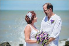 Wedding ceremony on the beach of Lake Erie at @lakehouseinn by Corey Ann Photography