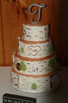 Four levels - each level a Four layer white wedding cake with strawberry buttercream and strawberry preserves between layers! Birch tree theme with fondant bark accents!