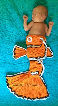 A clown fish ate my baby! Weird but cute crochet pattern on Ravelry. Crochet Mermaid Blanket, Crochet Fish, Crochet Mermaid Tail, Cute Crochet, Crochet For Kids, Crochet Crafts, Mermaid Blankets, Baby Blankets, Knit Crochet