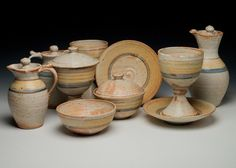 """pottery altar communion set in """"tan banded"""" style of decoration. There are two pottery chalice sets, cruets with stoppers, a flagon with stopper, and two ciboria. Communion Sets, Wine Goblets, Altar, Pottery, Passion, Illustrations, Ceramics, Decoration, Tableware"""