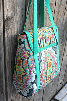 Sew Sweetness: Petrillo Bag.  I like the way the flap closes under the straps.