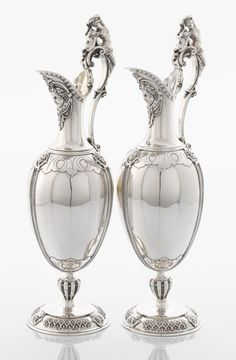 A PAIR OF VICTORIAN SILVER WINE JUGS. John Wilmin Figg, London,England, 1868-1869.