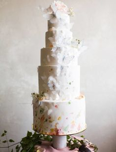 This delightfully whimsical cake decked out with butterflies and flowers.
