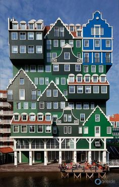 OMG it's like something out of a cartoon or something. Almost doesn't look real. But it's awesome that they used various different houses to make it. Inntel Hotel Zaandam, Amsterdam - Arteide