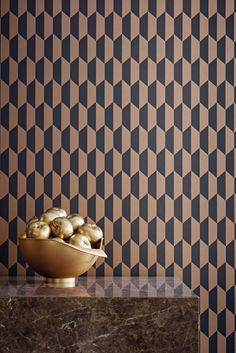 Petite Tile wallpaper design by Cole and Son in charcoal and shimmering bronze.