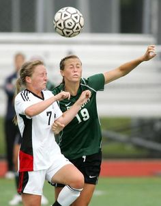 Whitman-Hanson's Lily Higgins, left, and Duxbury's Laura Nee compete for the ball during a soccer game on Monday, Sept. 10, 2012. Gary Higgins/The Patriot Ledger