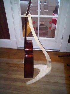 First and fore most I want to acknowledge Cgapay and his instructable on how to build a Guitar Stand. I also want to tip my hat to Take A Stand inc. for...