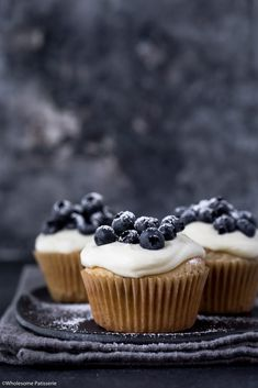 Blueberry Cupcakes with Cream Cheese Frosting! Blueberries folded through the softest gluten free vanilla cakes. Topped with heavenly cream cheese frosting, fresh blueberries & a dusting of icing sugar!