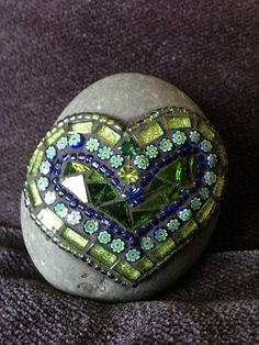 Lovely mosaic hearts on rocks!