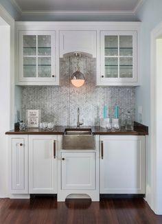 hammered sink + geometric marble backslash + sconce