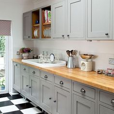 Stunning grey shaker style kitchen, with inlay style cabinet doors, featuring pewter effect cup drawer pulls and cabinet knobs. Finished with a beautiful oak worktop.