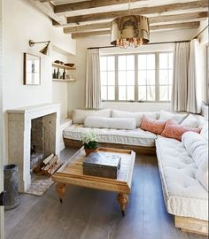 White and bright living room - Neutral - Rustic - Sectional in front of fireplace - Exposed beam ceiling