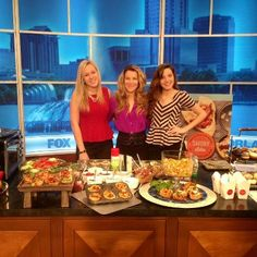 @LindsayHayhurst (L) and @LinseyDuca from Oviedo High School helping Hollis Wilder prepare a Potluxe Dinner™ pizza party on My Fox Orlando ( Fox 35 WOFL) set.