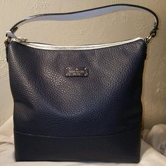 Kate Spade Absolutely Gorgeous Navy/White Purse Kate Spade Absolutely Gorgeous Navy/White Purse. This purse is Perfect!  No markings or imperfections at all! Kate Spade Bags